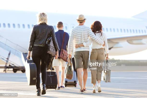 passengers boarding a flight - izusek stock pictures, royalty-free photos & images