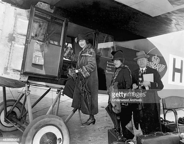 Passengers boarding a Fokker passenger plane enroute to Amsterdam Paris France mid 1920s