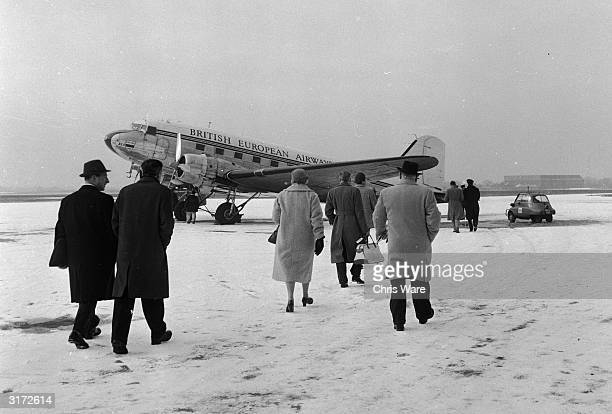 Passengers boarding a plane at Manchester Airport, travelling to the Isle of Man.