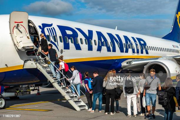 Passengers boarding a Ryanair Boeing 737800 aircraft with registration EIDHO early morning for a flight They board from Eindhoven EIN EHEH airport in...