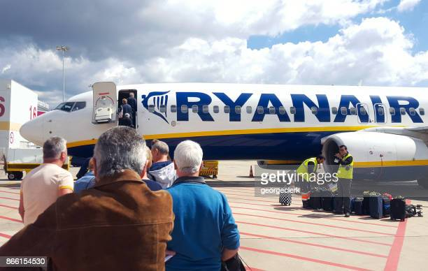 passengers boarding a ryanair flight - faro city portugal stock photos and pictures