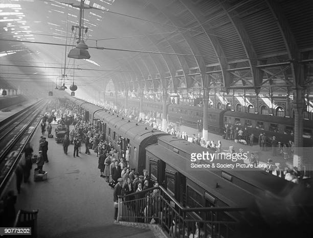 Passengers boarding a train for a Bank Holiday outing During the war taking a holiday was more difficult than it had been in peace time People had to...
