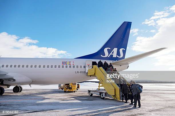 Passengers boarding aircraft from Scandinavian Airlines at Kiruna Airport, Sweden