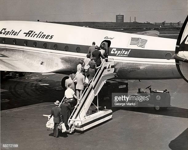 Passengers boarding airplane