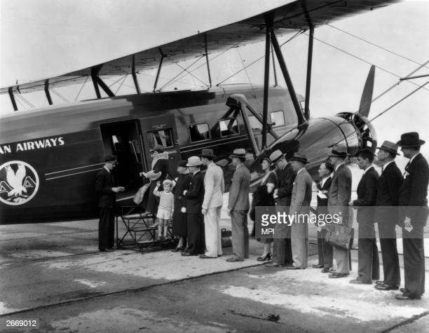 Passengers boarding an American Airlines Curtiss Condor plane