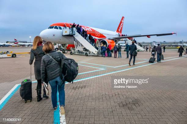 Passengers boarding an early morning EasyJet flight to Berlin from London's Gatwick Airport on March 22 2019 in Berlin Germany