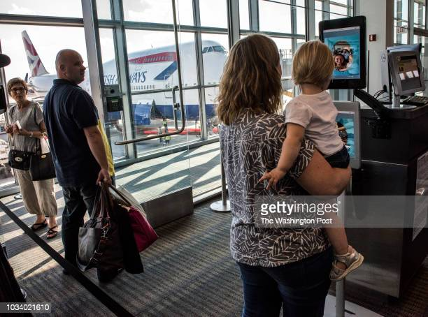 Passengers boarding an SAS flight to Copenhagen use a new biometric facial recognition scanner instead of a boarding pass on September 2018 in Dulles...