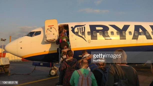 Passengers boarding on the Boeing 737800 aircraft of the low cost airline carrier Ryanair in Thessaloniki Macedonia Airport Greece Ryanair is a low...