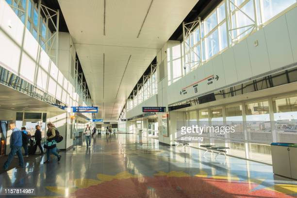 passengers boarding the skylink train at dallas fort worth international airport - dallas fort worth airport stock pictures, royalty-free photos & images