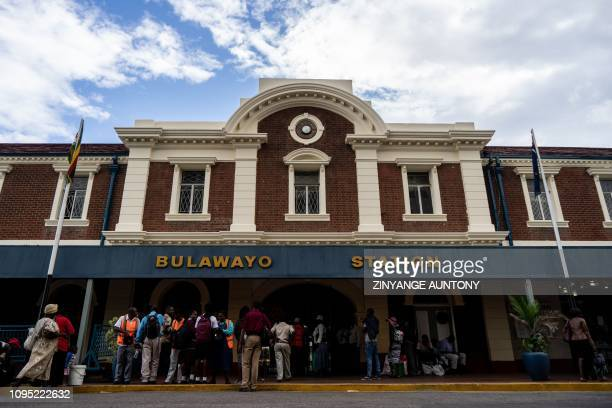 Passengers buy tickets at the main station for a commuter train to Cowdray Park and surrounding townships on January 28 in Bulawayo, Zimbabwe. -...
