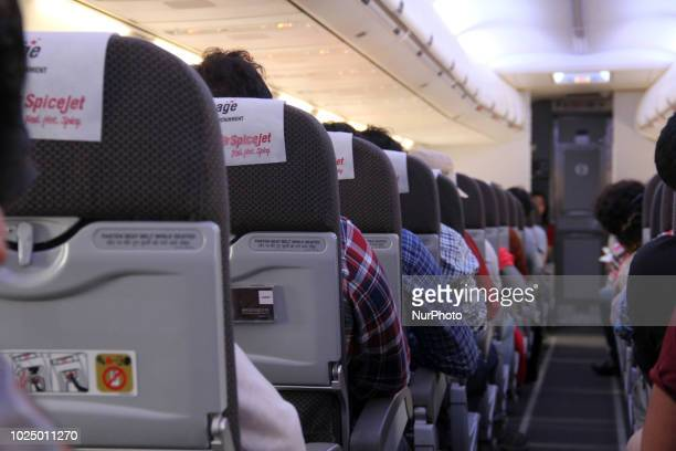 Passengers Can be seen in SrinagarDelhi bound SpiceJet Airline