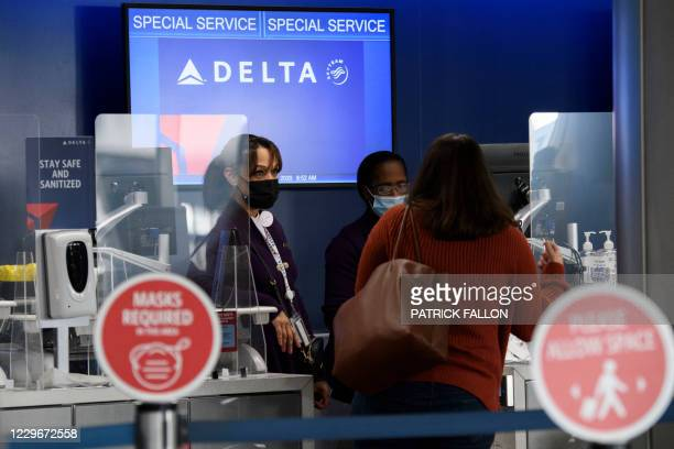 Passengers check bags for a Delta Air Lines, Inc. Flight during the Covid-19 pandemic at Los Angeles International Airport in Los Angeles,...