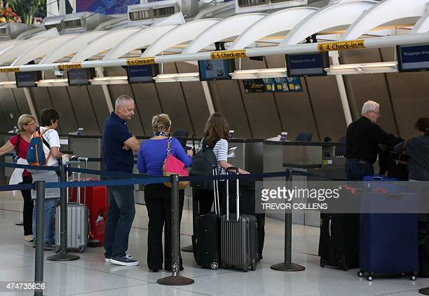 Passengers check in at an Air France counter at Terminal One in New York's John F Kennedy Airport May 25 2015 US warplanes were scrambled to escort...