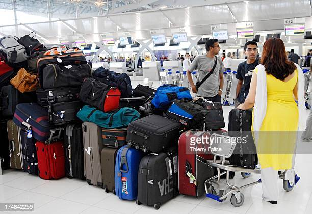 Passengers check in at Suvarnabhumi the new international and domestic Bangkok airport which finally opened on September 28 more than four decades...