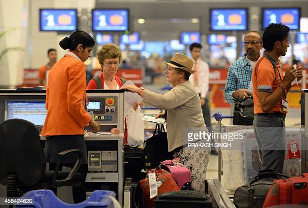 Passengers check in at the departure hall at Terminal 3 of Indira Gandhi International airport in New Delhi on November 5 2014 AFP PHOTO/ Prakash...