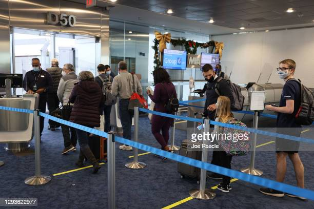 Passengers check in for American Airlines flight 718, a Boeing 737 Max, at Miami International Airport for their flight to New York on December 29,...