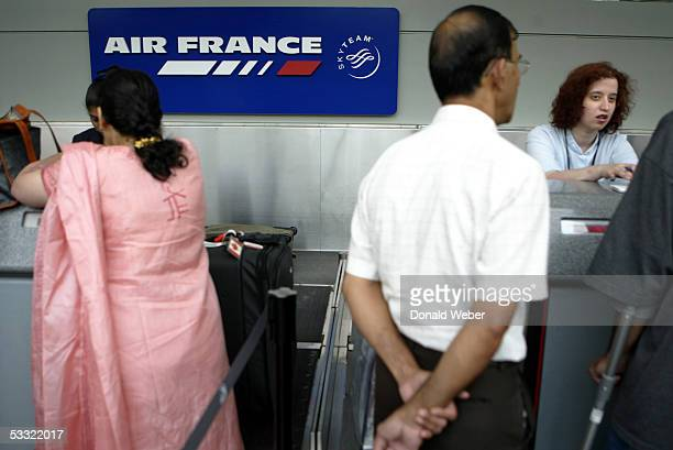 Passengers check in for an Air France flight to Paris at Pearson International Airport August 3 2005 in Toronto Canada Air France Flight 358 slid off...