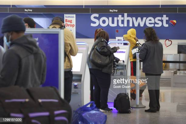 Passengers check in for Southwest Airlines flights at Midway International Airport on January 28, 2021 in Chicago, Illinois. Southwest Airlines today...