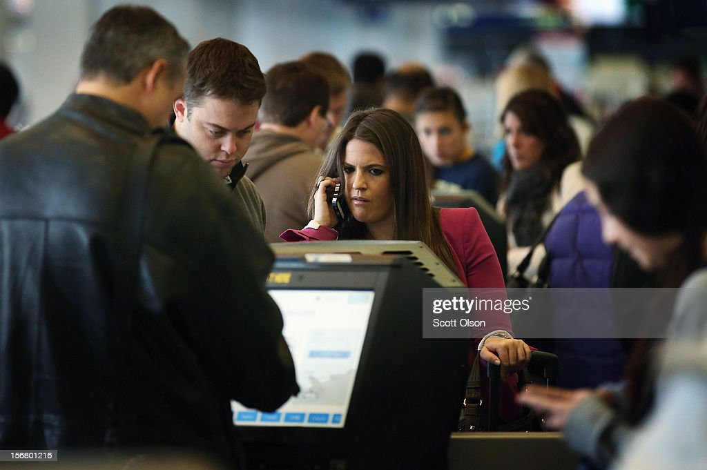 Passengers check in for their flights at O'Hare International Airport on November 21, 2012 in Chicago, Illinois. The Chicago Department of Aviation anticipates nearly 1.8 million passengers will travel through Chicago's two airports for the Thanksgiving holiday travel period between Tuesday, November 20 and Tuesday November 27.