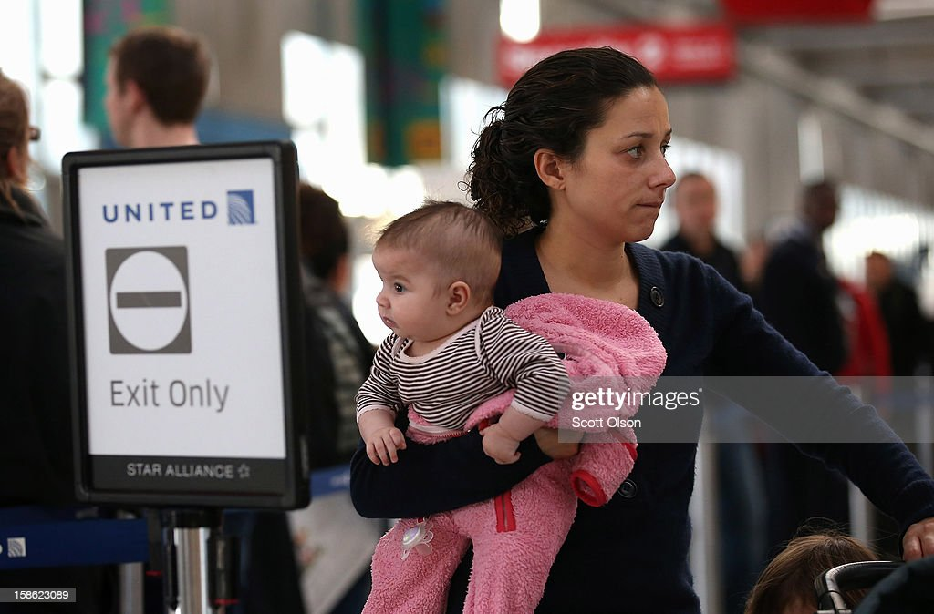 Passengers check in for their flights at O'Hare International Airport on December 21, 2012 in Chicago, Illinois. Today is the busiest air travel day of the Christmas holiday, with an estimated 200,000 travelers expected to travel through O'Hare today.