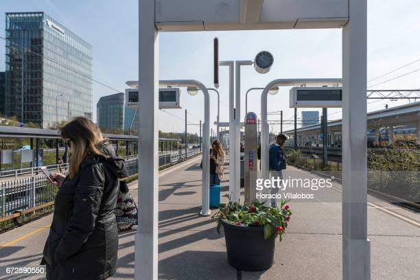 Passengers check their cellphones while waiting for a train at Amsterdam South Metro station on April 20 2017 in Amsterdam Netherlands The city's...