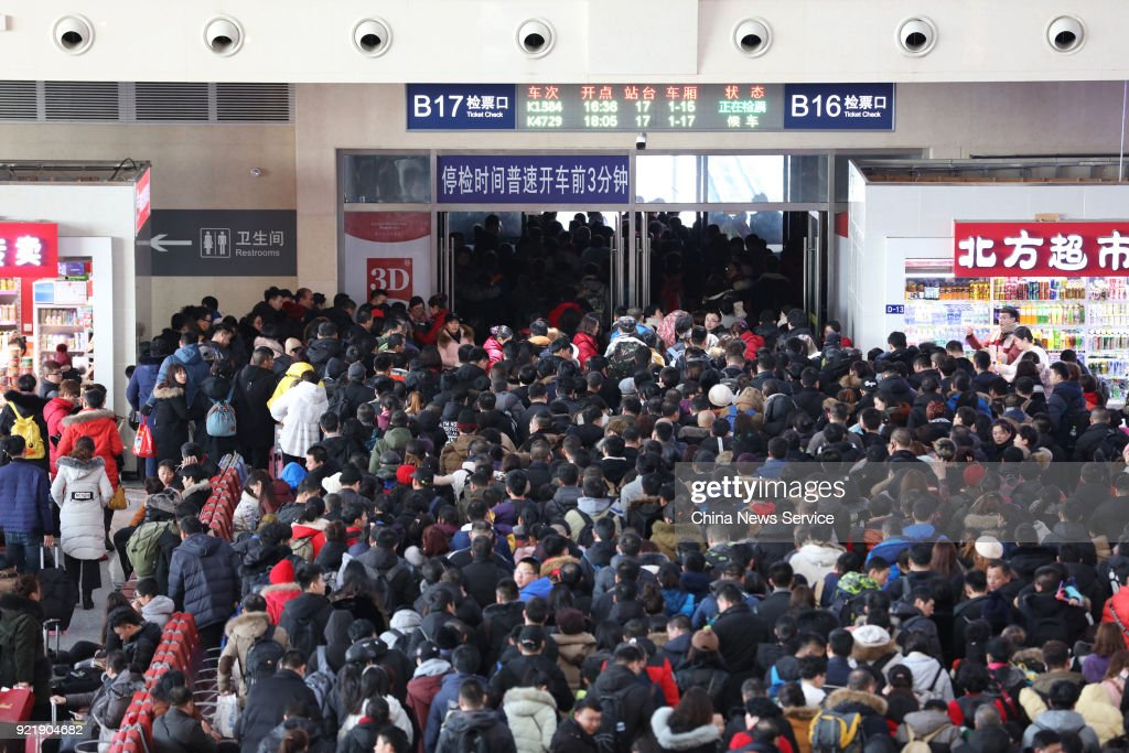 Passengers check to board the train as they started to return to school and work at Harbin West Railway Station on February 20, 2018 in Harbin, Heilongjiang Province of China. Harbin West Railway Station sees travel peak on the fifth day of the Lunar New Year.