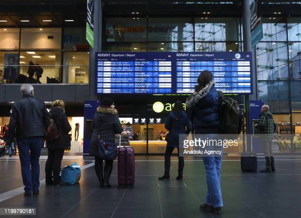 Passengers check to see cancelled trains because of the forecasted heavy storm 'Sabine' at Berlin Central Train Station on February 10, 2020 in...