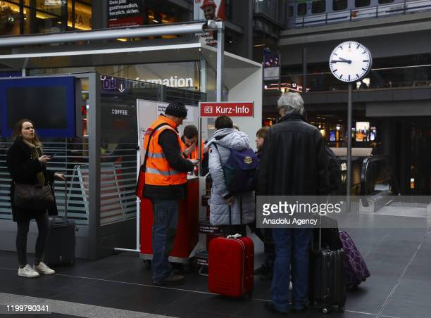 Passengers check to see cancelled trains because of the forecasted heavy storm 'Sabine' at Berlin Central Train Station on February 10 2020 in Berlin...