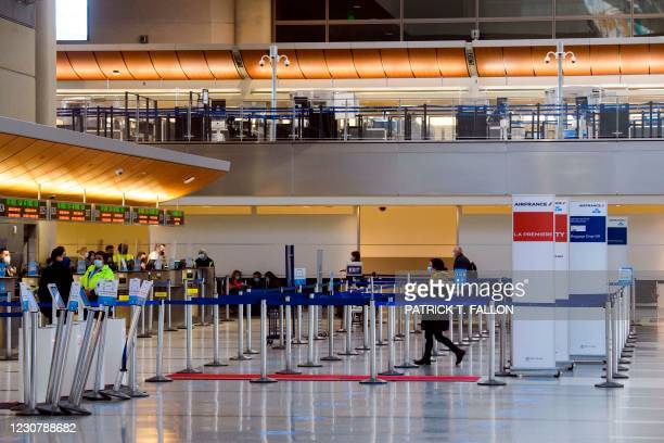 Passengers check-in for a flight at the Air France and KLM counter inside the Tom Bradley International Terminal at Los Angeles International Airport...