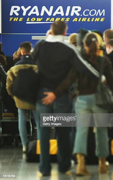 Passengers checkin for a Ryanair flight at Stanstead airport February 27 2003 near London England Budget airline Ryanair announced that it will cut...