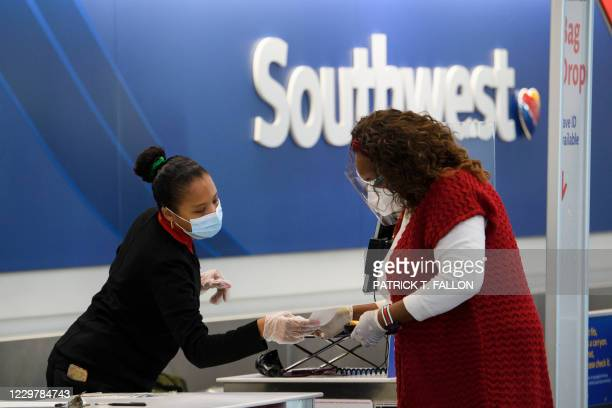 Passengers check-in for a Southwest Airlines flight at Los Angeles International Airport ahead of the Thanksgiving holiday in Los Angeles,...