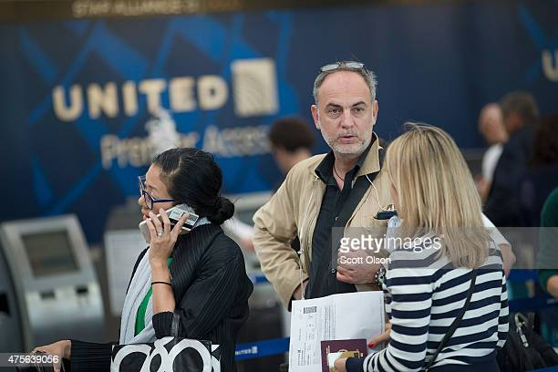 Passengers checkin for flights with United Airlines at O'Hare Airport on June 2 2015 in Chicago Illinois United travelers experienced widespread...