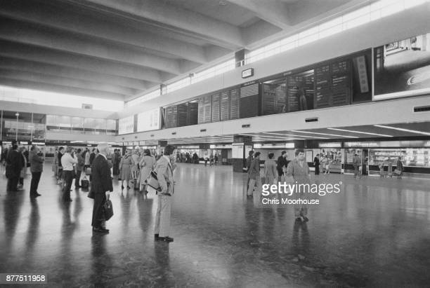 Passengers checking train boards in the waiting area at Euston Railway Station London UK 12th October 1978