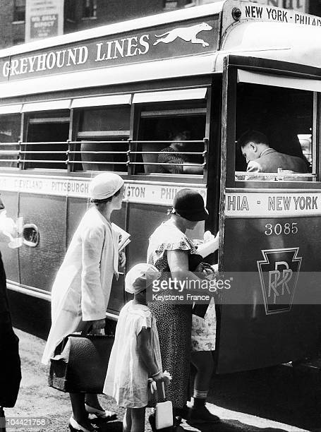 Passengers Climbing Into A Greyhound Bus In The United States Around 1930