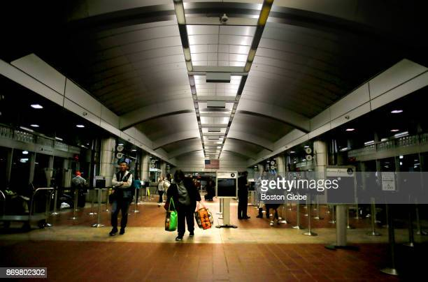 Passengers come and go inside the South Station bus terminal in Boston on Nov 1 2017 With a shortage in the bus driver ranks the Plymouth Brockton...