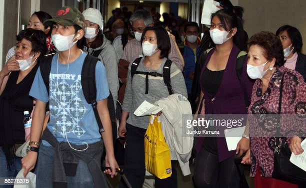 Passengers come out from an airplane arriving from Mexico via Vancouver Canada at Narita International Airport on April 29 2009 in Narita Japan Swine...