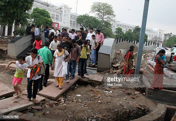 Passengers coming out from the Rajiv Chowk metro station after train services were disrupted for over an hour leading to utter chaos and causing...