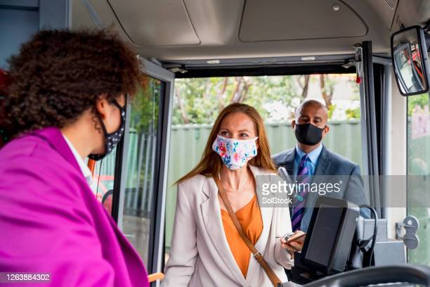 passengers commuting during a pandemic - bus stock pictures, royalty-free photos & images