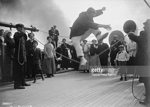 Passengers compete in a high jump contest on the deck of the Cunard cruise liner Franconia which was destroyed by a Uboat in 1916