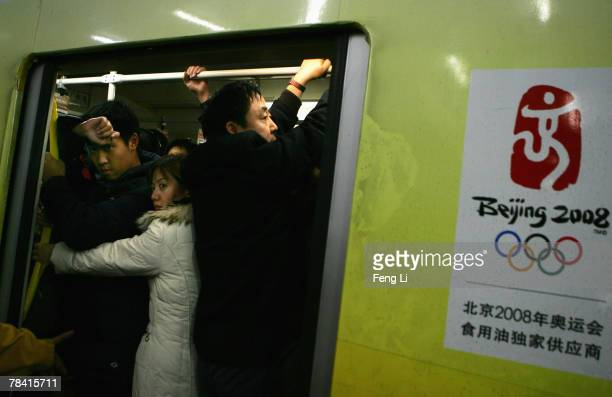 Passengers cram into a packed subway train on December 12 2007 in Beijing China Beijing is developing its subway system to boost the use of public...