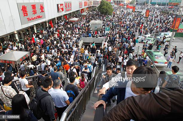 Passengers crowd at Zhengzhou Long Distance Bus Center the day before the National Day on September 30, 2016 in Zhengzhou, Henan Province of China....