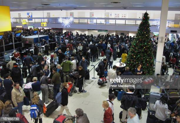 Passengers crowd into Terminal 1 at Heathrow Airport on December 20 2010 in London England Severe weather has caused major disruption at the United...