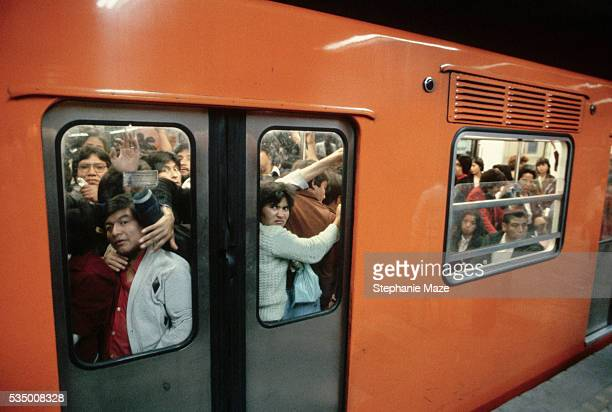 Passengers crowd onto Mexico City's Metro train at Pino Suarez station Millions of people use the Metro system every day
