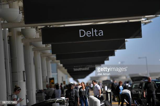 Passengers crowd the Denver International Airport after a Delta Air Lines complete shutdown August 08 2016 in Arvada CO