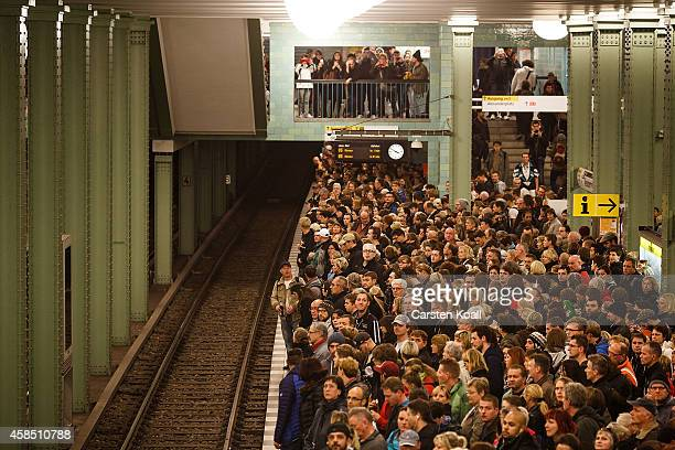 Passengers crowd the platform as they wait for the subway train retracted U5 line at the station Alexanderplatz during a fourday strike by the GDL...