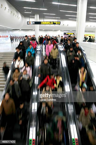 Passengers crowd the subway at People's square underground station on January 7 2009 in Shanghai China