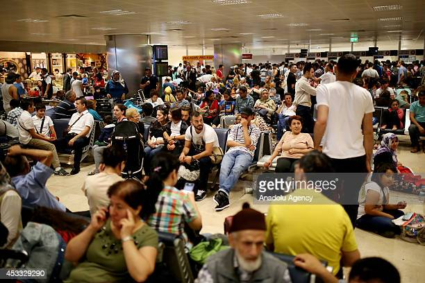Passengers crowd wait the hall of the Ataturk airport after many cancellation of flights continue in Istanbul Turkey on August 8 2014 Flights were...