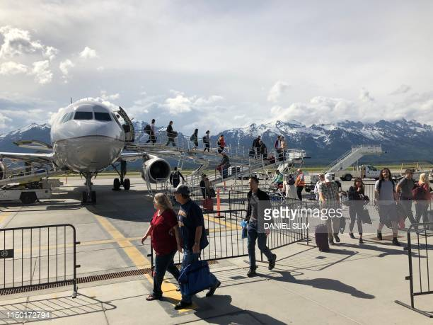 Passengers deplane at Jackson Hole Airport in Grand Teton National Park Wyoming on June 13 2019