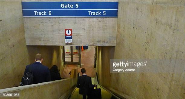 Passengers descending to the platform at Amtrak's 30th Street Station in Philadelphia
