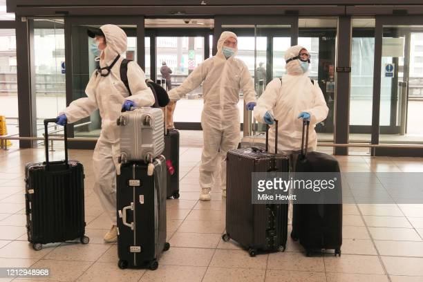 Passengers determined to avoid the coronavirus before leaving the UK arrive at Gatwick Airport on March 17 2020 in Gatwick United Kingdom Several UK...